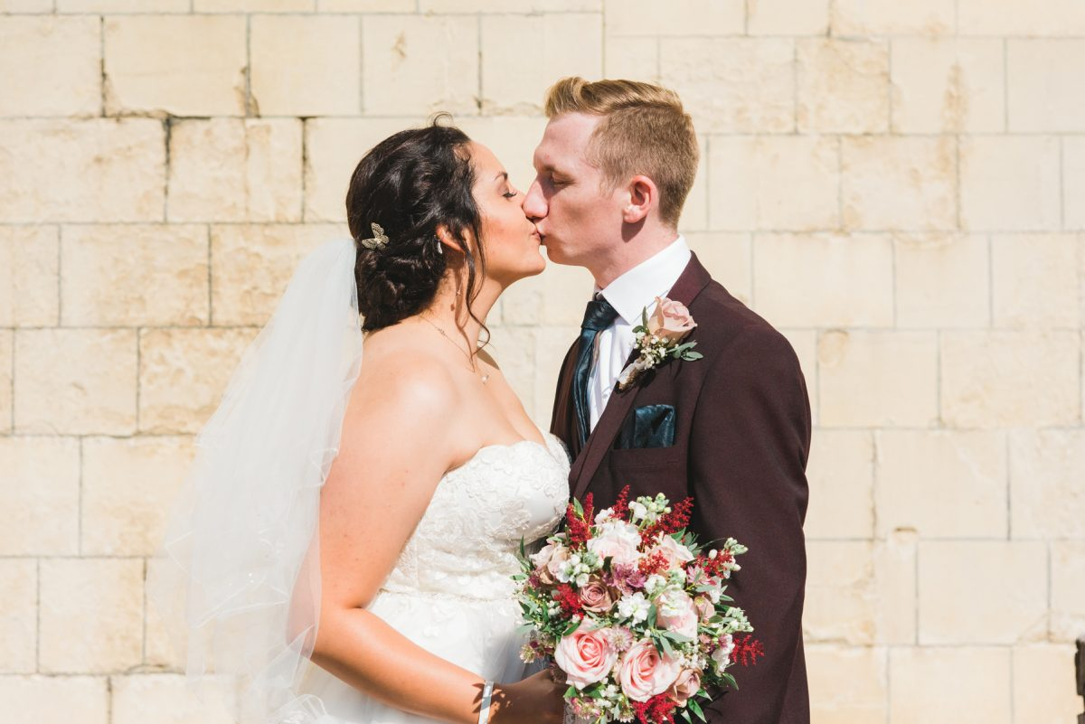 Norfolk Wedding Photographer - Bride and groom kissing at Norwich Castle.