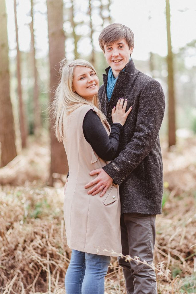Pre-Wedding - Couple Holding Each Other Closely In The Woods