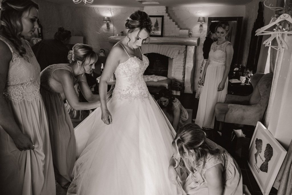 Wedding photographer in Norfolk capturing the final moments of prep at Pentney Abbey