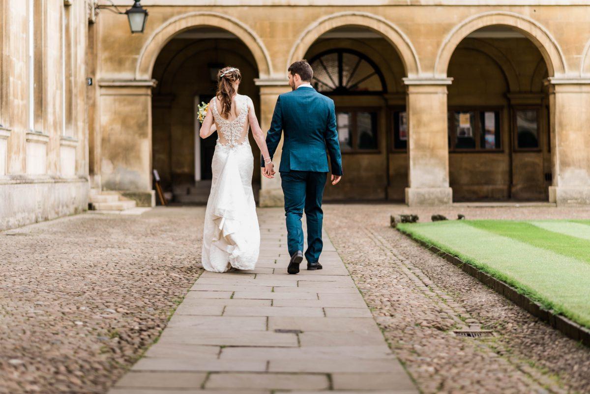 Wedding photographer in Norfolk - Bride and groom walking holding hands.