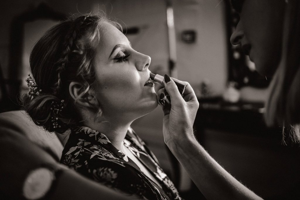 Wedding photographer in Norfolk capturing bridal prep at Pentney Abbey