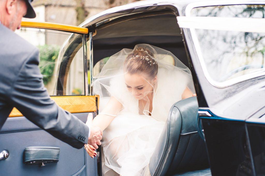 Wedding Photographer In Norfolk - Bride Arriving By Car