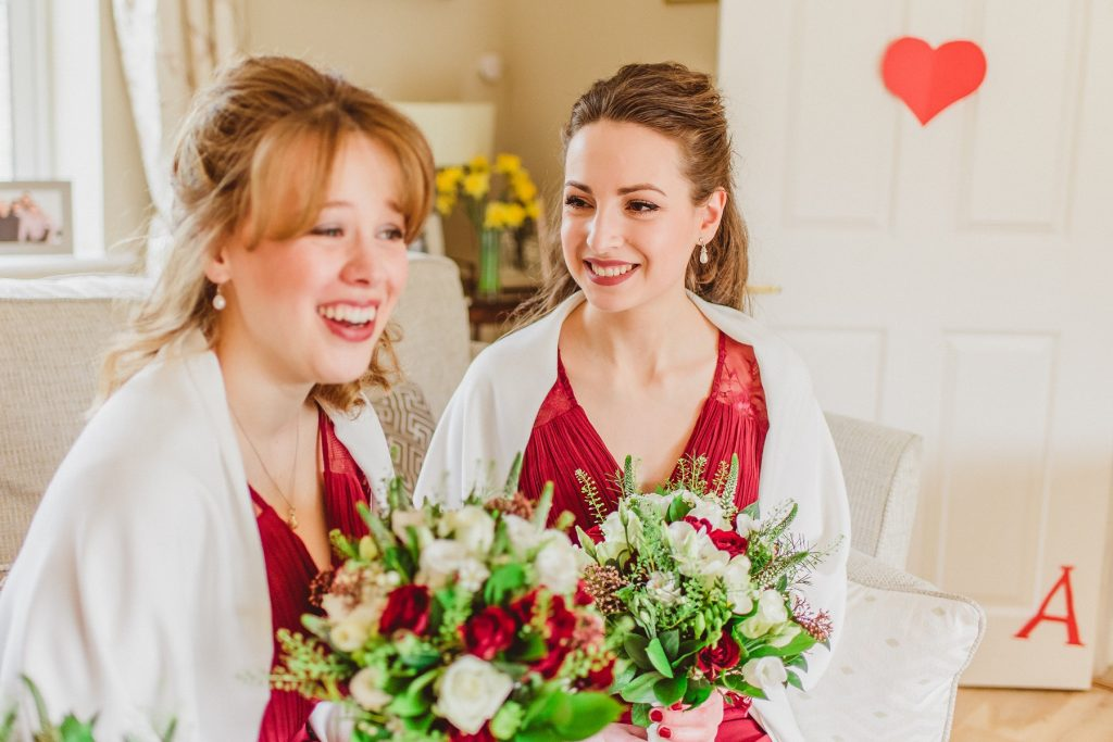 Norfolk Wedding Photographer - Bridesmaids On The Sofa Laughing Together