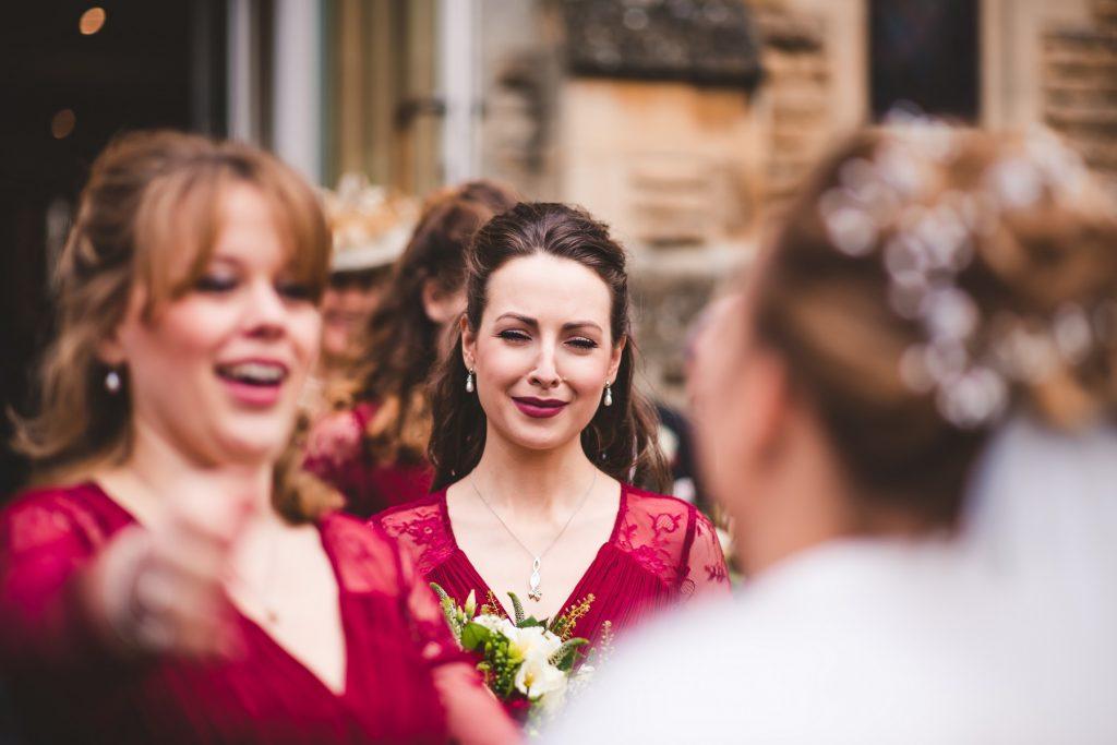 Wedding Photographer In Norfolk - Bridesmaids Congratulating The Bride
