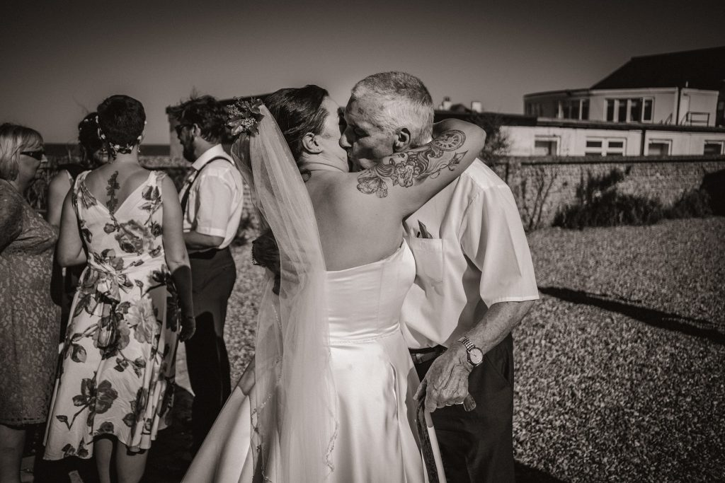 The bride hugging her grandad during the wedding reception