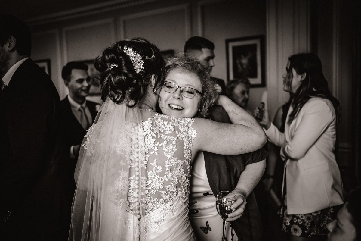 Bride hugging a close friend