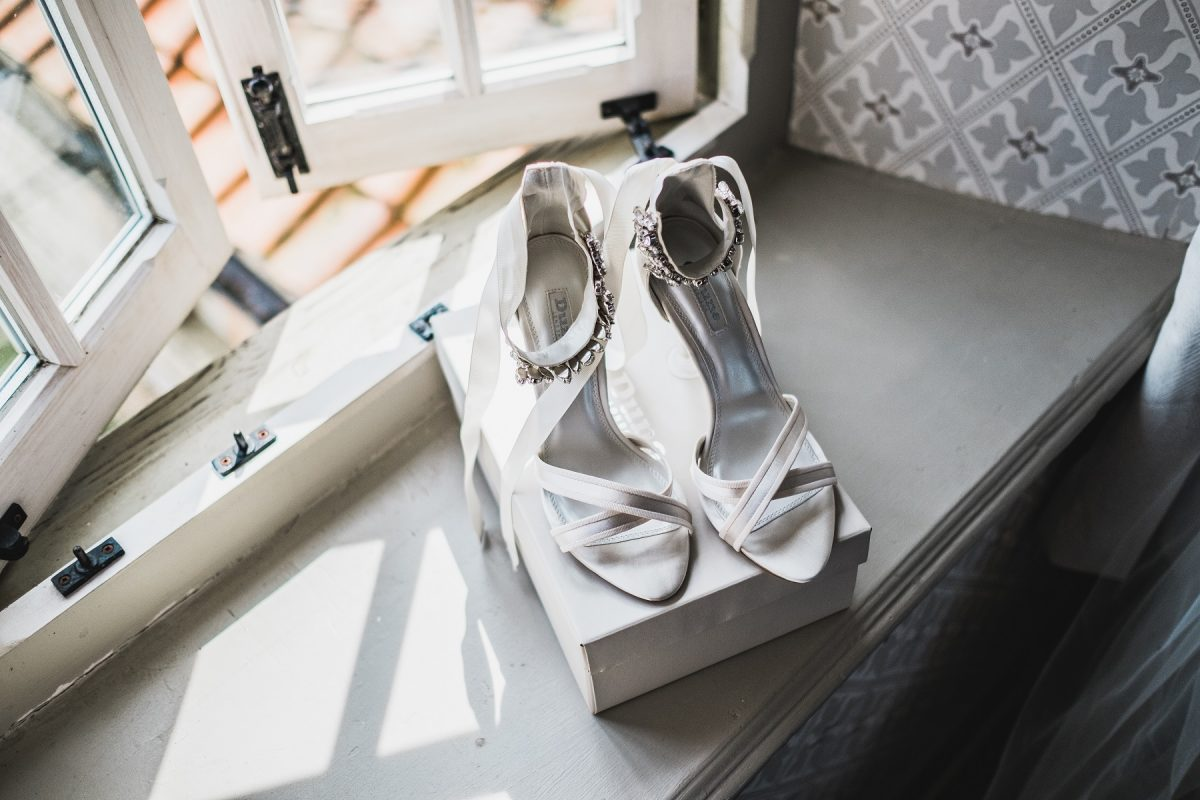 Bridal shoes on the window ledge at Pentney Abbey