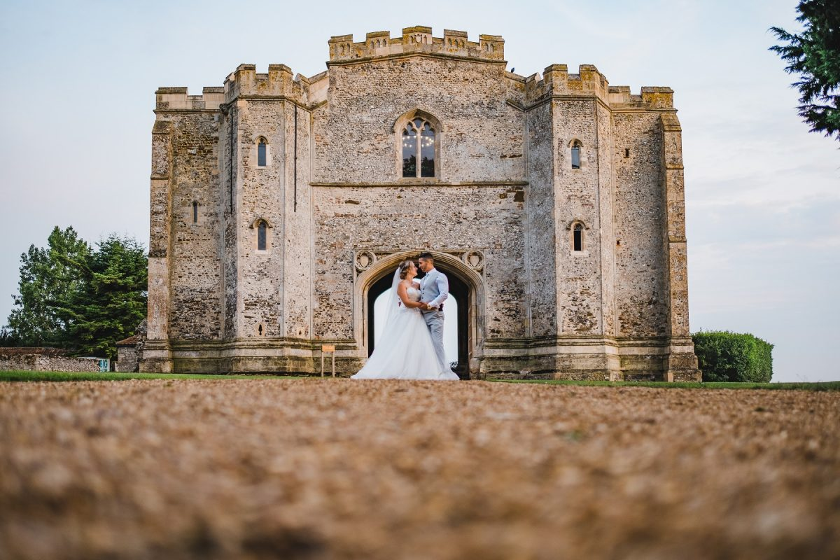 Bride and groom posing outside the Gatehouse