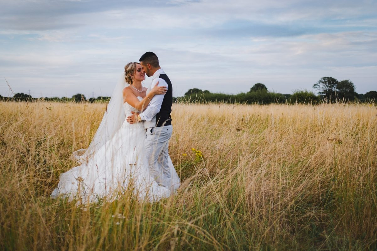 Bride and groom in the gold at Pentney Abbey
