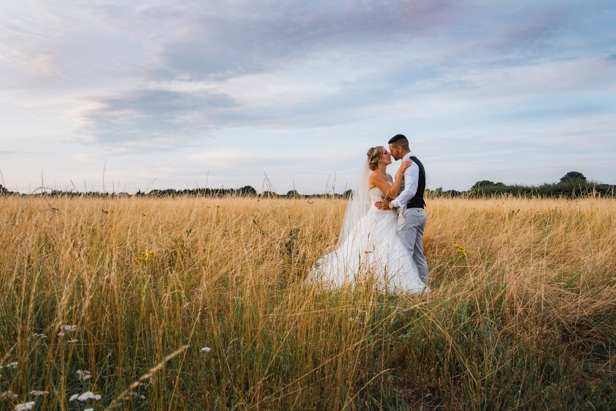 Wedding photographer in Norfolk during golden hour at Pentney Abbey