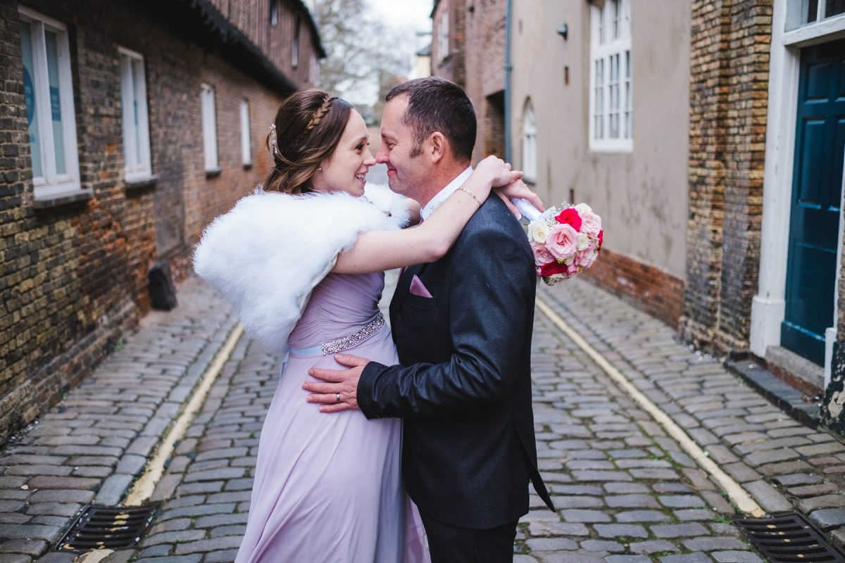 Bride and groom on a cobbled street