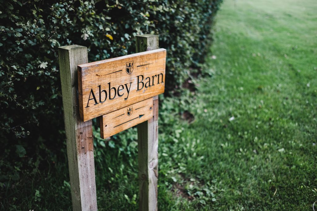 Pentney Abbey wooden sign pointed to the barn