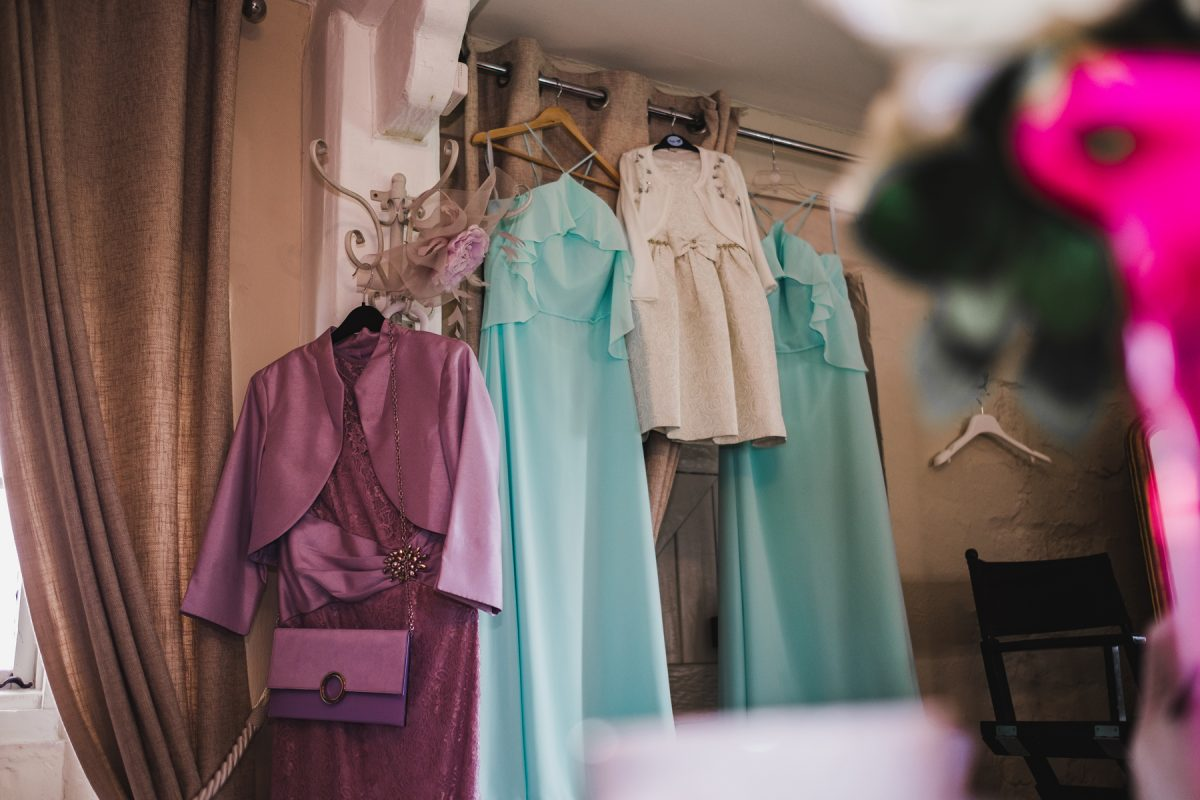 Bridesmaids dresses hanging at Pentney Abbey