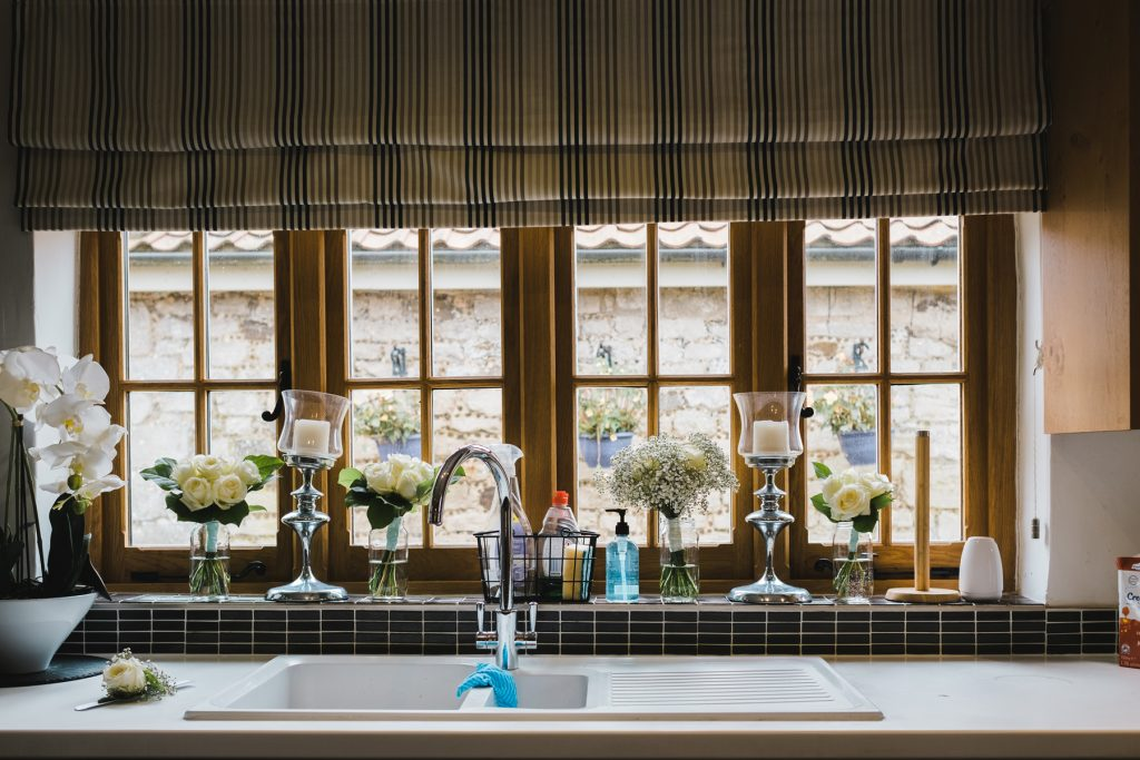 Wedding bouquets on the window ledge at Pentney Abbey
