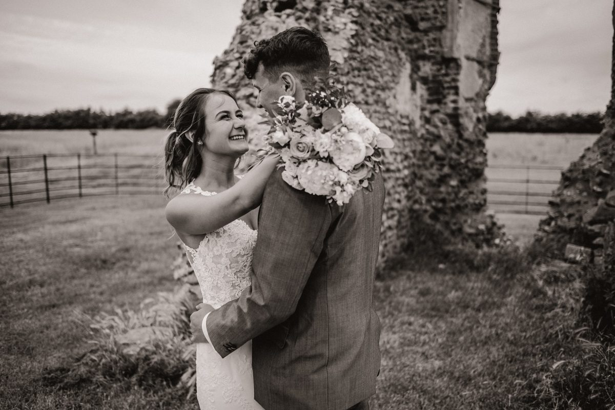 Bride and groom by the ruins at Godwick
