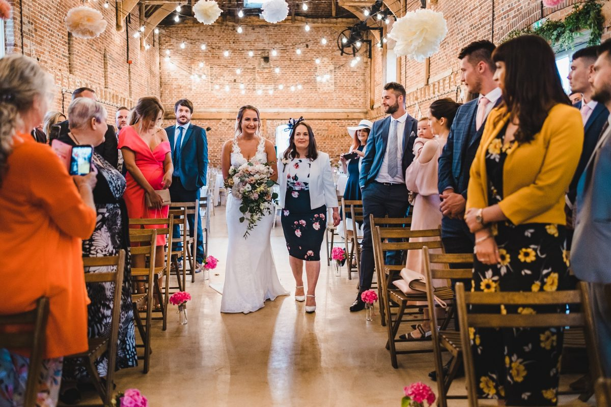 Walking down the aisle at Godwick Hall